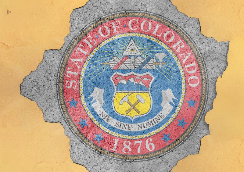 US state Colorado seal flag painted on concrete hole and cracked wall. Facade structure stock photo