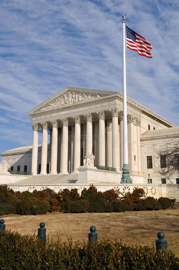 US Supreme Court Building with United States Flag. Blowing in wind royalty free stock image
