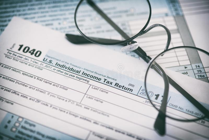 US tax form and glasses. Finance concept stock photo