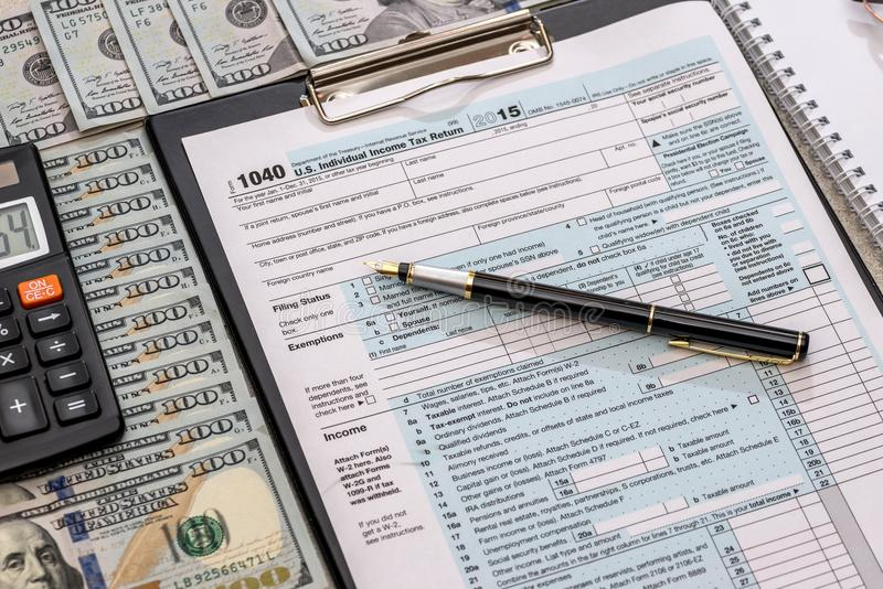 Us tax form with money.  stock photography