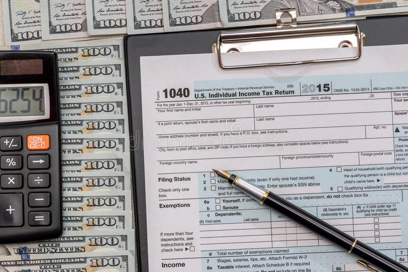 Us tax form with money. And pen royalty free stock photos