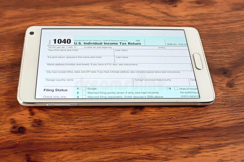 US tax form 1040. Open on smartphone stock photos