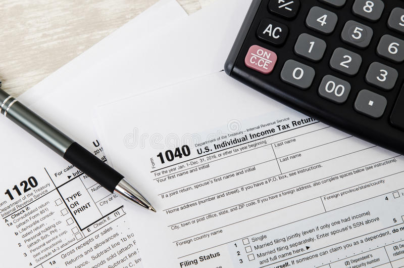 US tax form 1040 with pen and calculator. Tax form law document usa white mathematics business concept royalty free stock photo