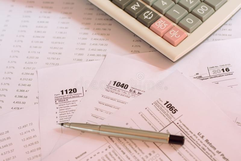 US tax form with pen and calculator selective focus / taxation c. Oncept stock image