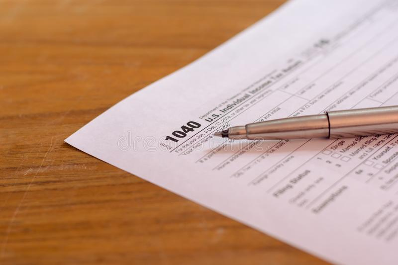 US tax form with pen and calculator selective focus / taxation c. Oncept royalty free stock photography