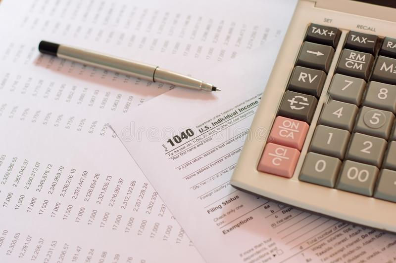 US tax form with pen taxation concept.  stock photos