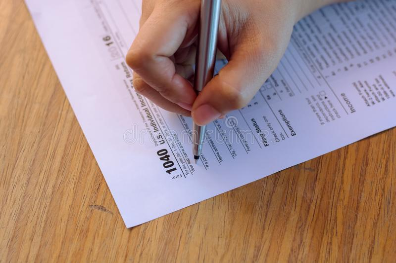 US tax form with pen taxation concept.  stock image
