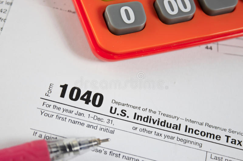 US tax form 1040. On table / taxation concept stock photography