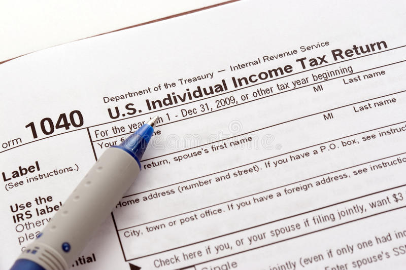 US Tax Return Form. US 1040 form for individual income tax return filing and pen stock photography