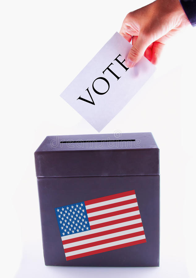 US Urn for vote. Urn for vote, with male hand posting vote and US banner stock photo