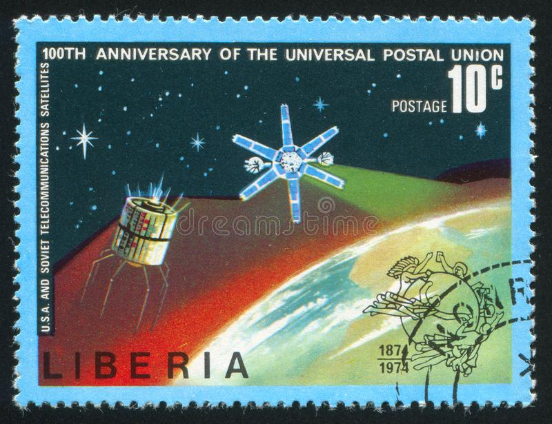 US and USSR telecommunication satellites. LIBERIA - CIRCA 1974: stamp printed by Liberia, shows US and USSR telecommunication satellites, circa 1974 stock photo