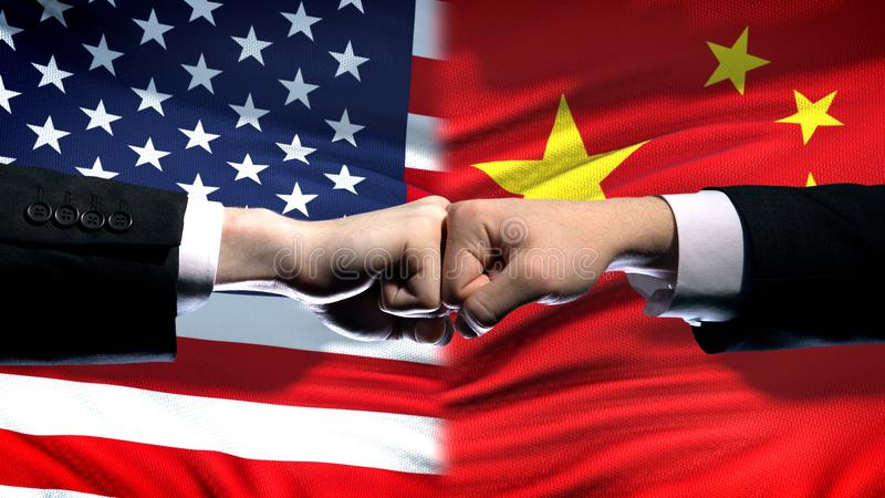 US vs China conflict, international relations crisis, fists on flag background. Stock photo stock photography