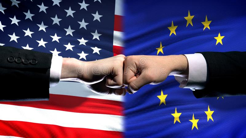 US vs European Union conflict, international relations, fists on flag background. Stock photo royalty free stock photos