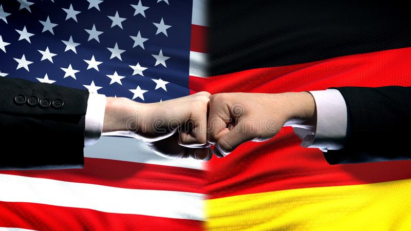 US vs Germany conflict, international relations crisis, fists on flag background. Stock photo royalty free stock photos