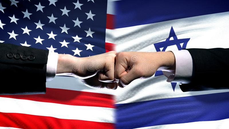 US vs Israel conflict, international relations crisis, fists on flag background. Stock photo royalty free stock images