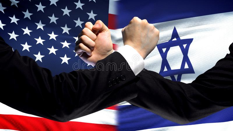 US vs Israel confrontation, countries disagreement, fists on flag background. Stock photo stock images