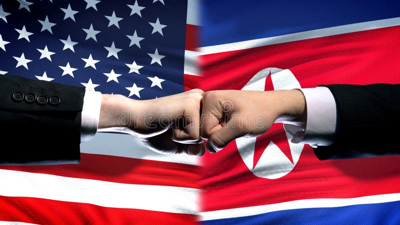 US vs North Korea conflict, international relations, fists on flag background. Stock photo stock photography
