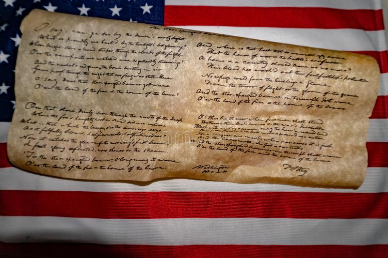 Usa America national anthem Star Spangled Banner on flag. Usa America national anthem Star Spangled Banner paper hand written on flag background stock photos