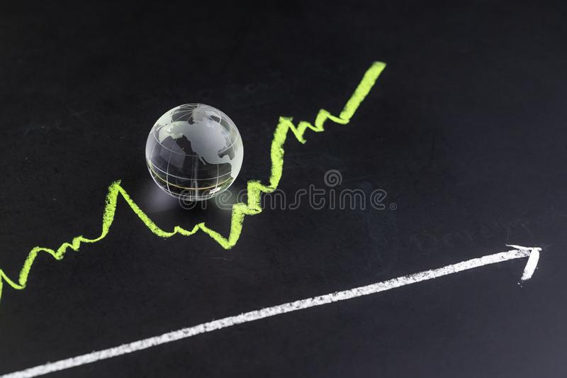 USA or America stock and investment growth, decorate shiny glass globe with United State map on dark black blackboard with chalk royalty free stock image