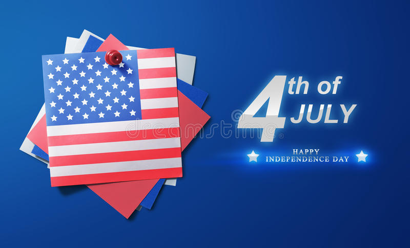 USA American flag paper pinned with 4th of July message. Over blue background stock photo