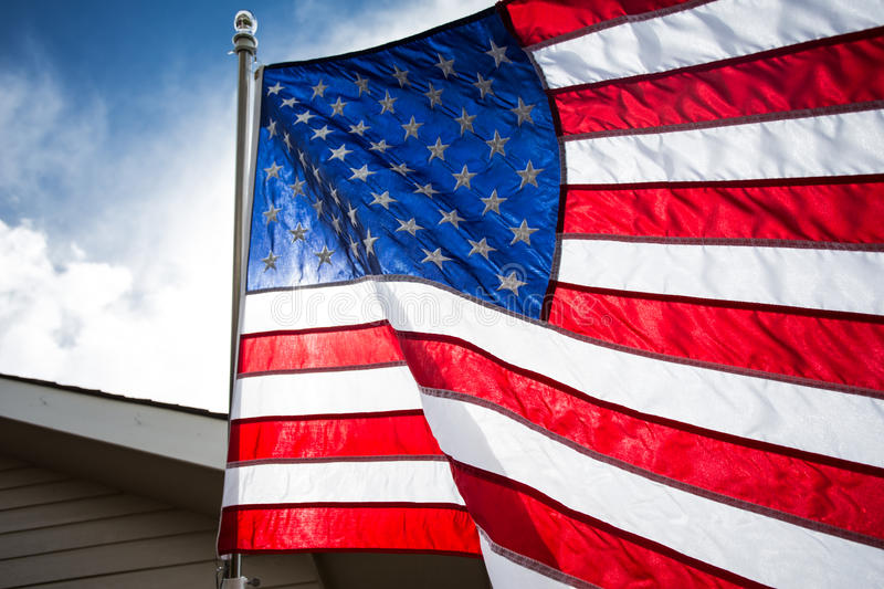 USA,American flag,rhe symbolic of liberty,freedom,patriotic,honor,american family,kids,nation with overtoned color and selective. USA.American flag for flag day royalty free stock image