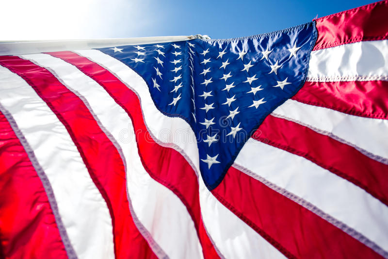 USA,American flag,rhe symbolic of liberty,freedom,patriotic,honor,american family,kids,nation with overtoned color and selective. Focus royalty free stock photo