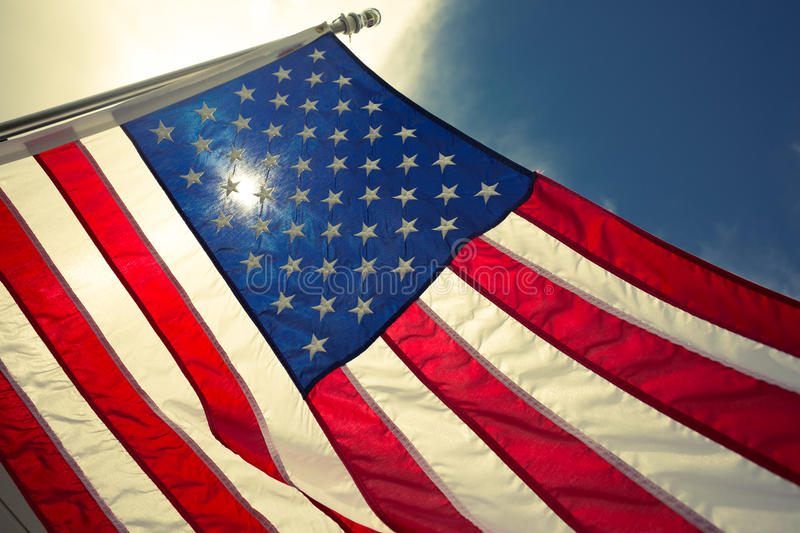 USA,American flag,rhe symbolic of liberty,freedom,patriotic,honor,american family,kids,nation with overtoned color and selective. Focus royalty free stock images