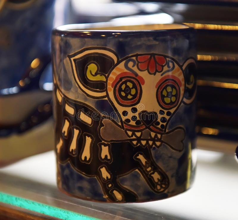Mexican cups with skulls in the souvenir shop stock image