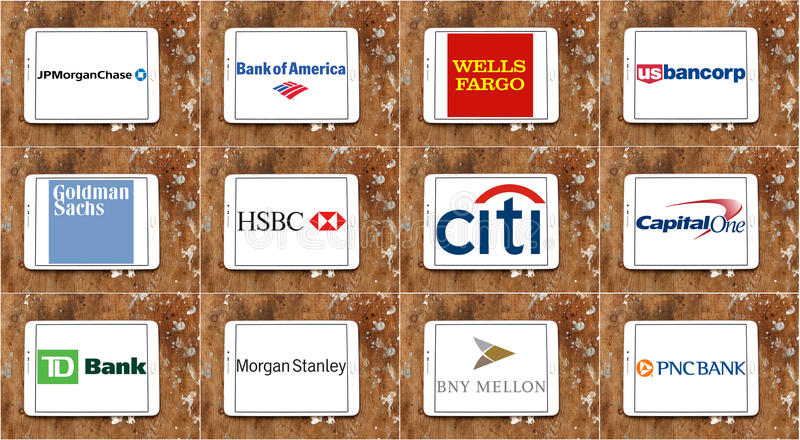 Usa banks brands and logos. Group of logos and brands of top famous banks in the united states of america on white tablet on rusted wooden background. banks like royalty free stock image