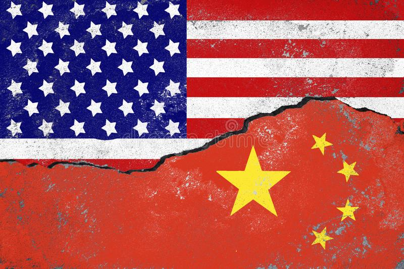 USA and China conflict concept.Flags of USA and China painted on cracked wall royalty free stock images