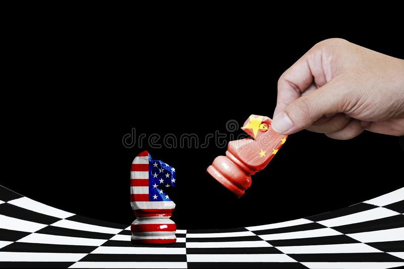 USA and China flag print screen on horse chess with black background.It is symbol of economic tariffs trade war tax barrier stock photo