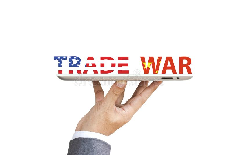 USA and China flag print screen to trade war wording with Businessman  who hold up tablet for risk managment during economic royalty free stock photo