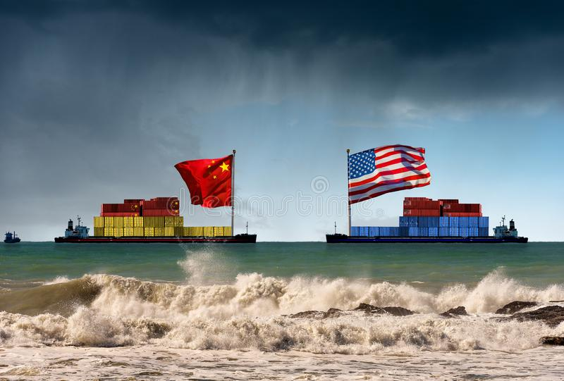 USA and China trade war - Two cargo container ships in the rough sea. USA and China trade war concept. Two cargo container ships with the Chinese and United royalty free stock image