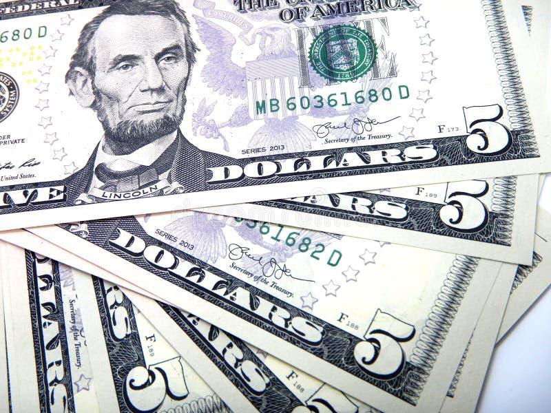 Money, five US dollar banknotes royalty free stock image