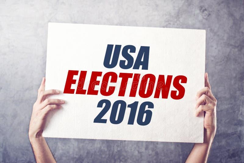 USA elections 2016, man holding poster stock photos