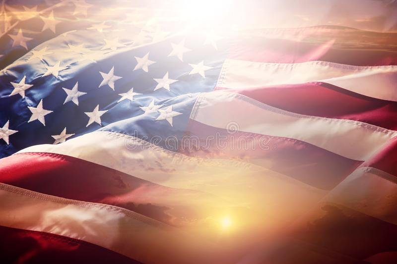 USA flag. American flag. American flag blowing wind at sunset or stock images