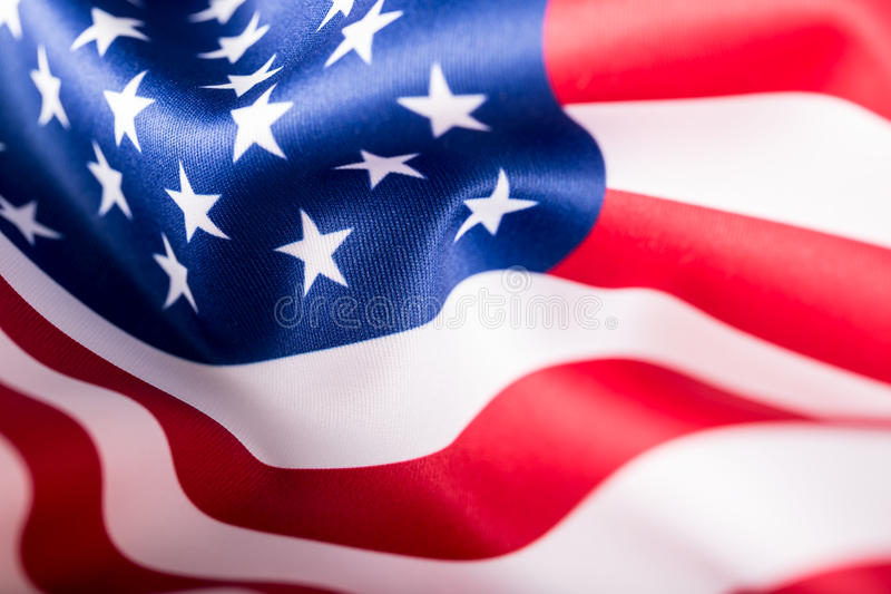 USA flag. American flag. American flag blowing wind. Close-up. Studio shot royalty free stock photos