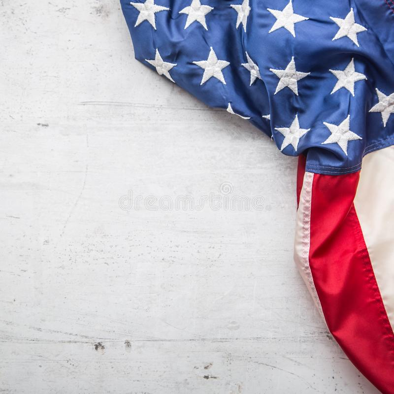 USA flag. American flag. Top of view American flag freely lying on white concrete background. Close-up Studio shot royalty free stock photos