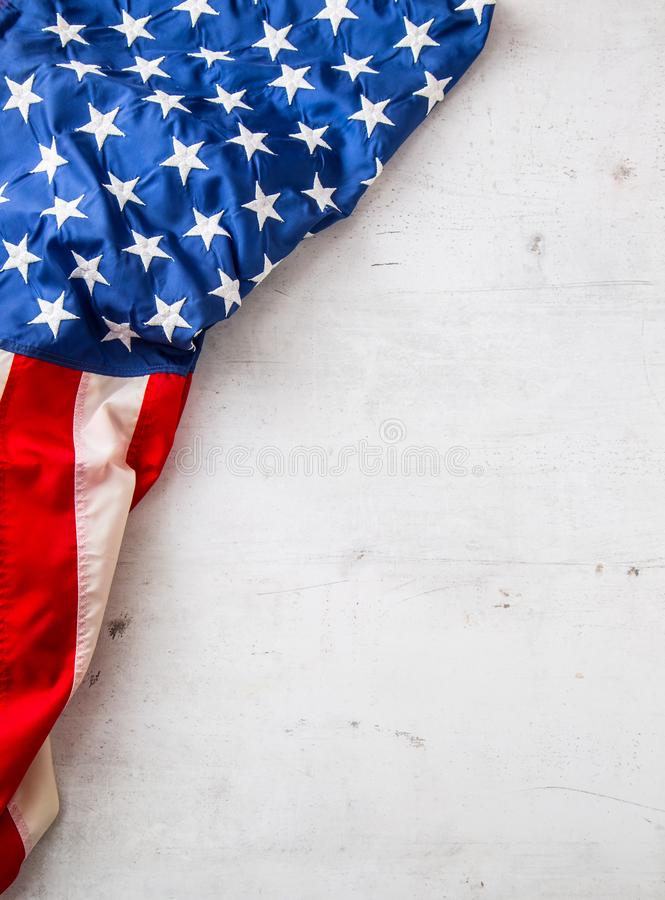USA flag. American flag. Top of view American flag freely lying on white concrete background. Close-up Studio shot stock photography
