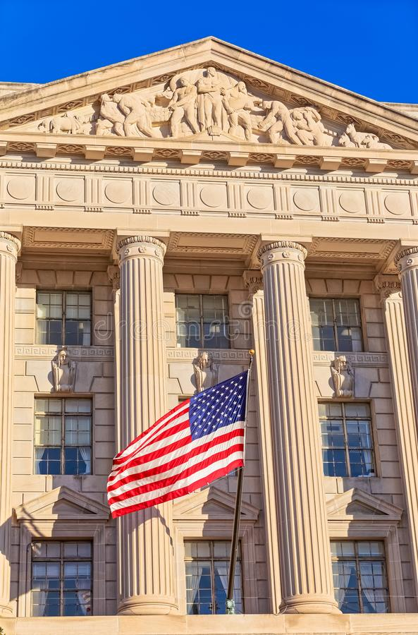 USA flag on facade of US Commerce building in Washington DC stock photography