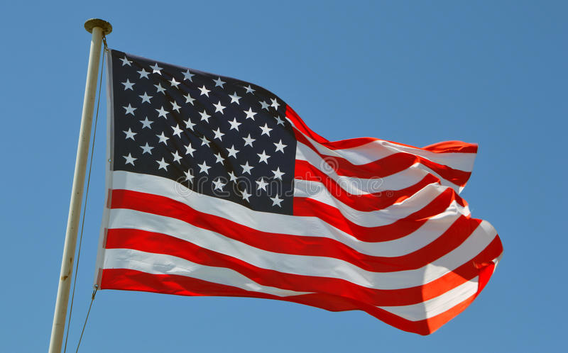 A USA flag. Flies in a strong wind stock image