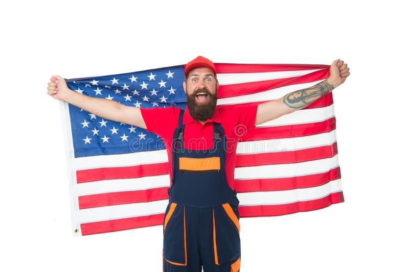 USA flag is flown higher than the others. Bearded man holding american flag on independence day. Patriotic worker. Celebrating flag day. Happy hipster in stock photography