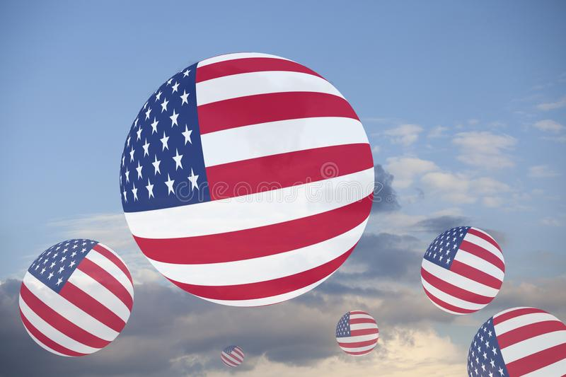 USA Flag Globes on sky. With clouds stock photography