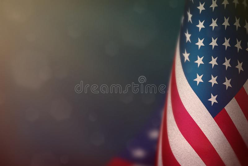 USA flag for honour of veterans day or memorial day. Glory to the USA heroes of war concept on light blue dark velvet background. USA hanging flag for honour of stock image
