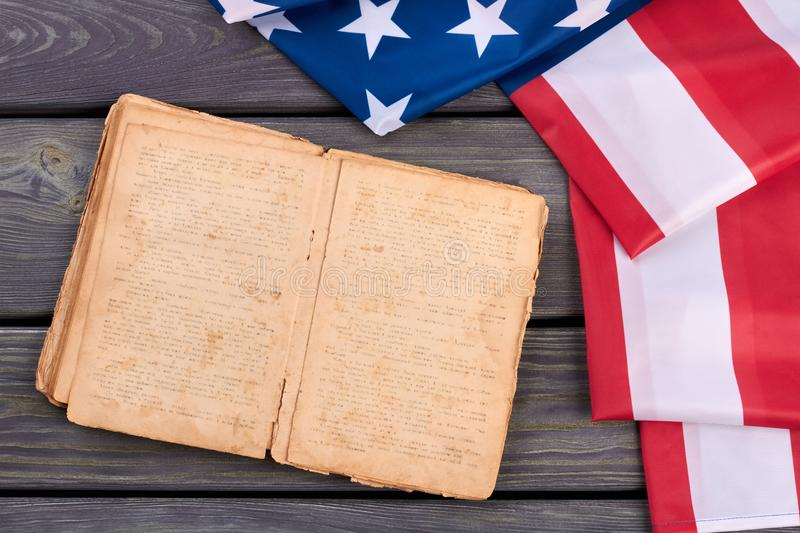 USA flag and old opened book. stock photo