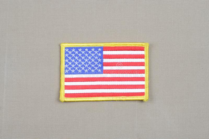 USA flag patch on desert uniform. USA flag patch on desert camouflage uniform royalty free stock image