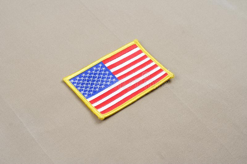 USA flag patch on desert uniform. USA flag patch on desert camouflage uniform royalty free stock photography