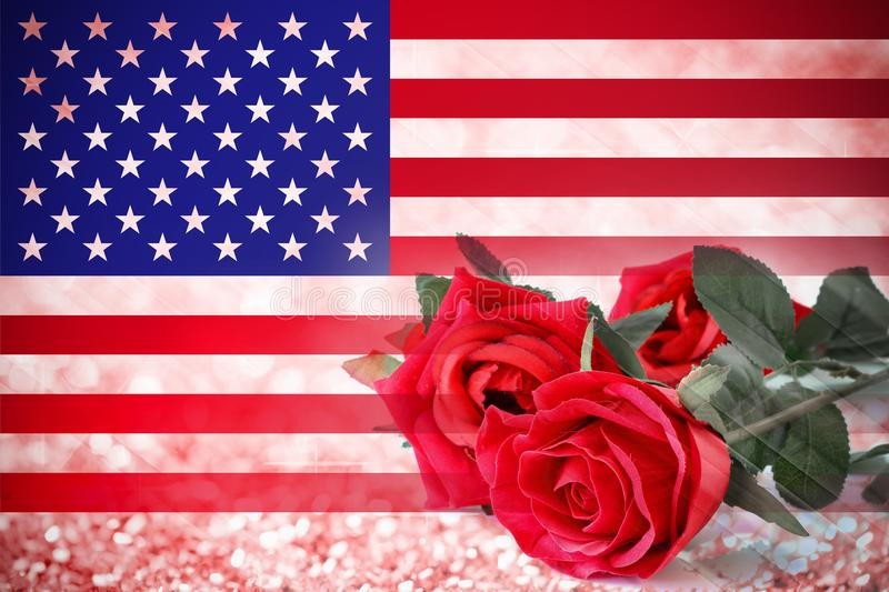 USA flag and red roses flowers background. American flag and red roses flowers on bokeh abstract twinkled bright background royalty free stock photography