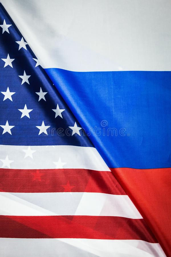 Usa flag and Russia flag background. Textile flags royalty free stock photos