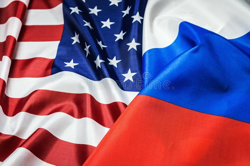 Usa flag and Russia flag background. Textile flags of the world stock photography